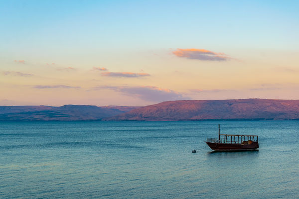 Boat on sea of Galilee at sunset