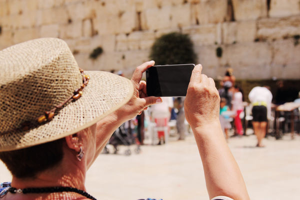 Elderly Woman Takes Picture At Western Wall